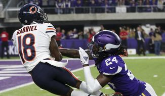 Chicago Bears wide receiver Taylor Gabriel (18) catches a pass over Minnesota Vikings defensive back Holton Hill (24) during the first half of an NFL football game, Sunday, Dec. 30, 2018, in Minneapolis. (AP Photo/Jim Mone)