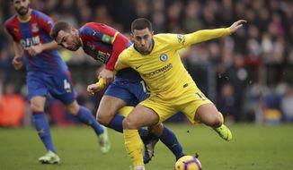 Chelsea's Eden Hazard and Crystal Palace's James McArthur, left, during their English Premier League soccer match at Selhurst Park in London, Sunday Dec. 30, 2018. (John Walton/PA via AP)