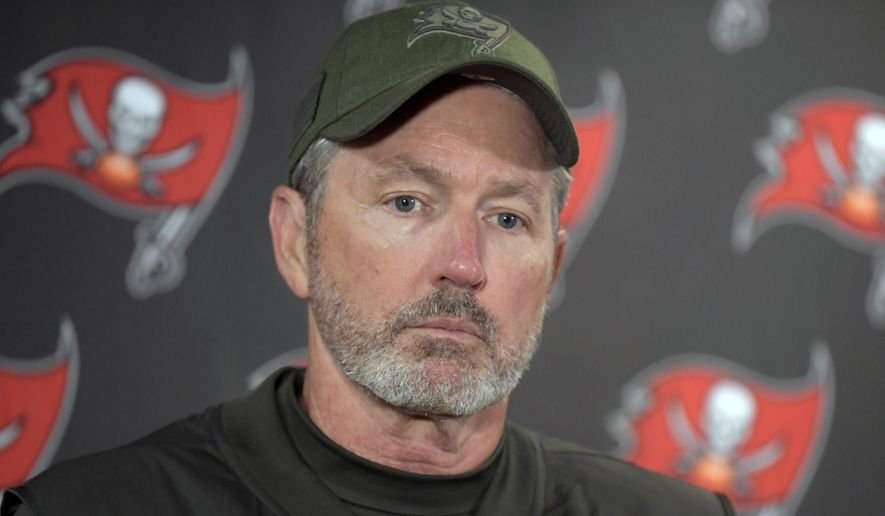 FILE - In this Sunday, Nov. 18, 2018 file photo, Tampa Bay Buccaneers head coach Dirk Koetter talks to reporters after an NFL football game against the New York Giants in East Rutherford, N.J.  Dirk Koetter has been fired as coach of the Tampa Bay Buccaneers. The team made the announcement Sunday night, Dec. 30, 2018 a little more than three hours after the Bucs concluded a disappointing season with a 34-32 loss to the Atlanta Falcons. (AP Photo/Bill Kostroun, File) **FILE**