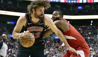 Chicago Bulls center Robin Lopez (42) drives to the net against Toronto Raptors center Greg Monroe (15) during the first half of an NBA basketball game, Sunday, Dec. 30, 2018 in Toronto. (Frank Gunn/The Canadian Press via AP)