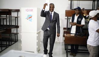 Ruling party presidential candidate Emmanuel Ramazani Shadary casts his vote Sunday, Dec. 30, 2018 in Kinshasa, Congo. Forty million voters are registered for a presidential race plagued by years of delay and persistent rumors of lack of preparation. (AP Photo/Jerome Delay)