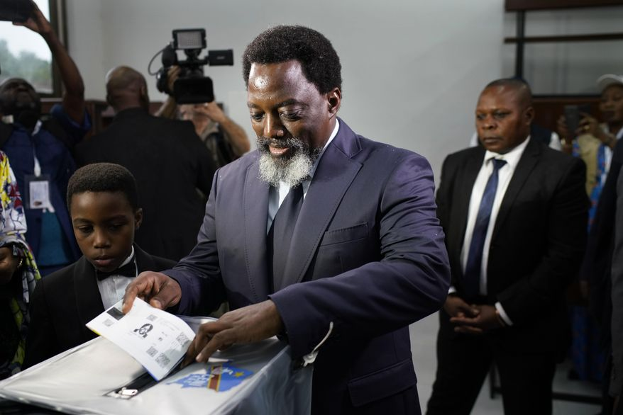 Congolese President Joseph Kabila casts his vote Sunday, Dec. 30, 2018 in Kinshasa, Congo. Forty million voters are registered for a presidential race plagued by years of delay and persistent rumors of lack of preparation. (AP Photo/Jerome Delay)