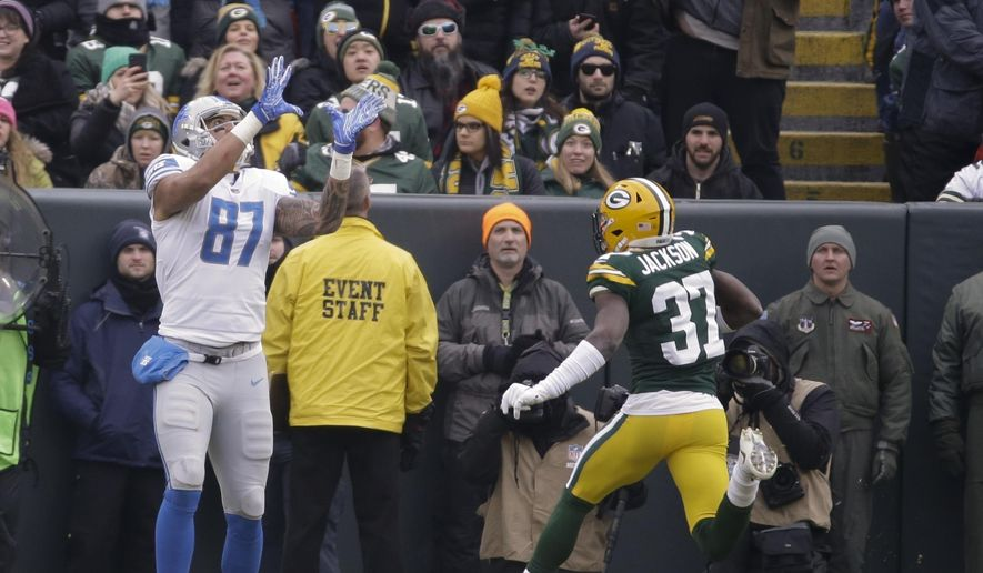 d61f54db02c ... Detroit Lions  Levine Toilolo catches a touchdown pass on a fake field  goal in front of Green Bay Packers  Josh Jackson during the first half of  an NFL ...