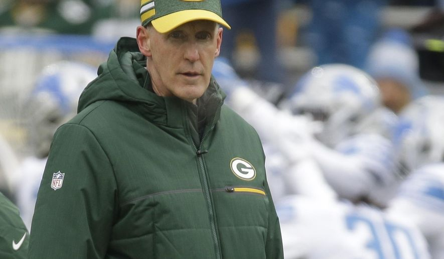 CORRECTS TO REMOVE SCORE- Green Bay Packers head coach Joe Philbin watches as players warm up before an NFL football game against the Detroit Lions Sunday, Dec. 30, 2018, in Green Bay, Wis. (AP Photo/Mike Roemer)