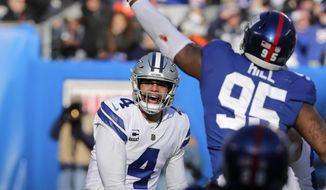 Dallas Cowboys quarterback Dak Prescott, left, throws during the first half of an NFL football game against the New York Giants, Sunday, Dec. 30, 2018, in East Rutherford, N.J. (AP Photo/Frank Franklin II)