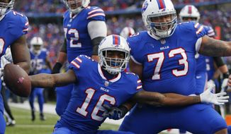 Buffalo Bills wide receiver Robert Foster (16) and offensive tackle Dion Dawkins (73) celebrate after Foster caught a 5-yard touchdown pass during the second half of an NFL football game, Sunday, Dec. 30, 2018, in Orchard Park, N.Y. (AP Photo/Jeffrey T. Barnes)