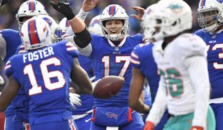 Buffalo Bills quarterback Josh Allen (17) celebrates after running back LeSean McCoy scored a 5-yard touchdown during the second half of an NFL football game against the Miami Dolphins, Sunday, Dec. 30, 2018, in Orchard Park, N.Y. (AP Photo/Adrian Kraus)