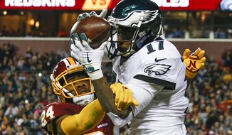 Philadelphia Eagles wide receiver Alshon Jeffery (17) pulls in a touchdown pass under pressure from Washington Redskins cornerback Josh Norman (24) during the first half of the NFL football game between the Washington Redskins and the Philadelphia Eagles, Sunday, Dec. 30, 2018 in Landover, Md. (AP Photo/Alex Brandon) **FILE**