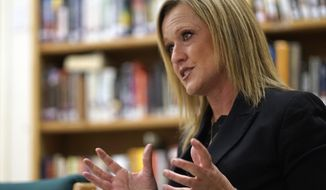In this Dec. 6, 2018, photo, Monique Jacobson, outgoing secretary of the state Children, Youth and Families Department, speaks during an interview at the Youth Diagnostic and Development Center in Albuquerque, N.M. The development center, a locked and secure facility in Albuquerque for incarcerated youths, is one of Jacobson's favorite places to visit. In terms of adult intervention in the lives of troubled kids, the outgoing cabinet secretary says this is where the rubber meets the road. (Adolphe Pierre-Louis/The Albuquerque Journal via AP)