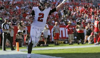 Atlanta Falcons quarterback Matt Ryan (2) celebrates after catching a 5-yard touchdown pass from Mohamed Sanu during the second half of an NFL football game against the Tampa Bay Buccaneers Sunday, Dec. 30, 2018, in Tampa, Fla. (AP Photo/Mark LoMoglio)