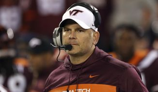 FILE - In this Oct. 25, 2018, file photo, Virginia Tech coach Justin Fuente awaits the start of the team's NCAA college football game against Georgia Tech in Blacksburg Va.  Now, Virginia Tech (6-6) must defeat Cincinnati on Monday, Dec. 31, to avoid its first losing season since 1992. (Matt Gentry/The Roanoke Times via AP, File) **FILE**