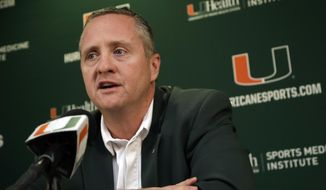 Miami athletic director Blake James speaks during a news conference after head football coach Mark Richt announced his retirement, Sunday, Dec. 30, 2018, in Coral Gables, Fla. (AP Photo/Lynne Sladky)