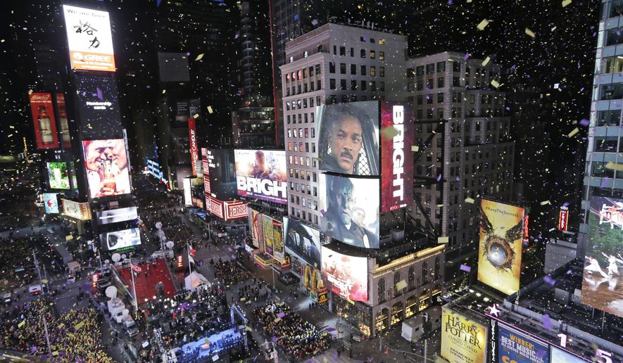 Confetti flies over Times Square during the New Year's celebration in New York. The New York Police Department is adding a drone this year to the security forces it uses to protect the huge crowds celebrating New Year's Eve in the city. (AP Photo/Seth Wenig, File)