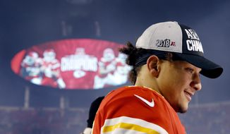 Kansas City Chiefs quarterback Patrick Mahomes talks to a reporter after an NFL football game against the Oakland Raiders, Sunday, Dec. 30, 2018, in Kansas City, Mo. (AP Photo/Charlie Riedel)