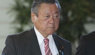 FILE - In this Oct. 2, 2018, file photo, Japan's Minister in Charge of Tokyo Olympics Yoshitaka Sakurada arrives at the prime minister's official residence in Tokyo. Sakurada, also the minister in charge of cybersecurity, is in the spotlight for acknowledging he had never used a computer and making comments showing he had no idea what a USB port might be. (AP Photo/Koji Sasahara, File)