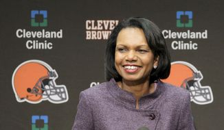 In this Oct. 21, 2010, file photo former Secretary of State Condoleezza Rice talks with the media after visiting with the Cleveland Browns coaches and players at the Browns training facility in Berea, Ohio. (AP Photo/Amy Sancetta, File)
