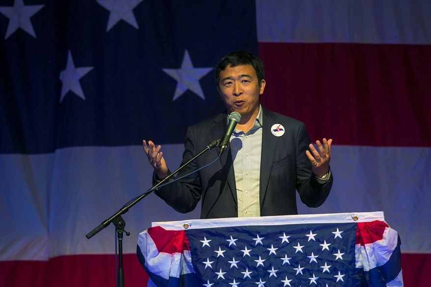 """""""We need to accelerate and evolve as an economy and a society and the most direct way to build a more human-centered economy is through a universal basic income or 'Freedom Dividend' of $1,000 per adult per month,"""" said Democratic presidential hopeful Andrew Yang. (Associated Press)"""