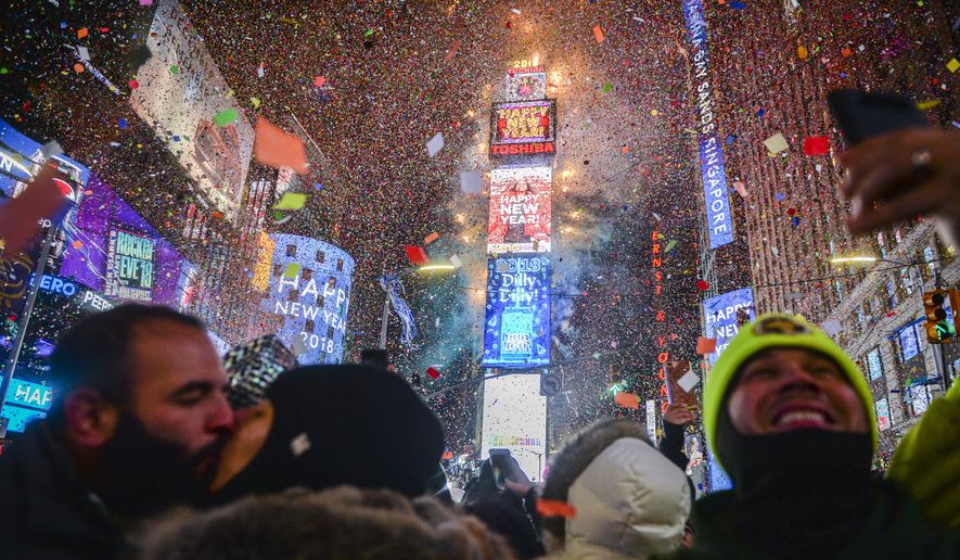 People Celebrate New Year As Confetti Fall Down After The