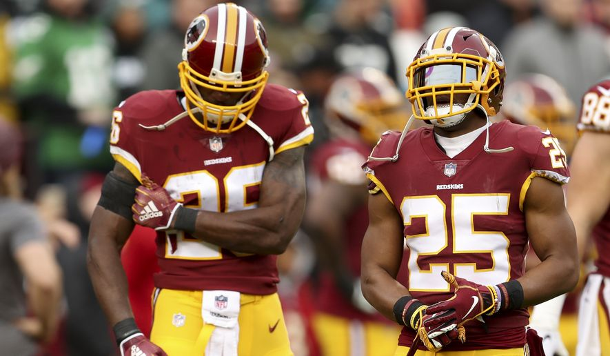 Washington Redskins running back Adrian Peterson, left, and Washington Redskins running back Chris Thompson, right, during warmups before an NFL football game against the Philadelphia Eagles, Sunday, Dec. 30, 2018, in Landover, Md. The Eagles defeated the Redskins 24-0. (AP Photo/Andrew Harnik) **FILE**