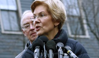 Sen. Elizabeth Warren, D-Mass., speaks beside her husband Bruce Mann, left, outside their home, Monday, Dec. 31, 2018, in Cambridge, Mass., where she confirmed that she is launching an exploratory committee to run for president. Warren on Monday took the first major step toward launching a widely anticipated campaign for the presidency, hoping her reputation as a populist fighter can help her navigate a Democratic field that could include nearly two dozen candidates. (AP Photo/Bill Sikes) ** FILE **