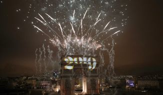 Fireworks explode over the Arc de Triomphe during the New Year's Day celebrations on the Champs Elysees, in Paris, Tuesday, Jan. 1, 2019. (AP Photo/Kamil Zihnioglu)