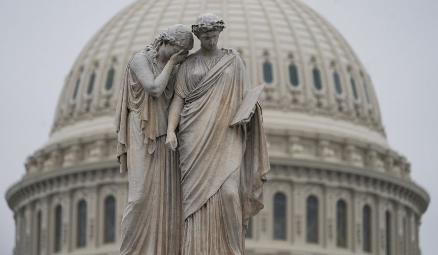 The U.S. Capitol Dome is seen behind the Peace Monument statue in Washington, Monday, Dec. 31, 2018, as a partial government shutdown stretches into its second week. A high-stakes move to reopen the government will be the first big battle between Nancy Pelosi and President Donald Trump as Democrats come into control of the House. The new Democratic House majority gavels into session this week with legislation to end the government shutdown. Pelosi and Trump both think they have public sentiment on their side in the battle over Trump's promised U.S.-Mexico border wall. (AP Photo/J. Scott Applewhite)