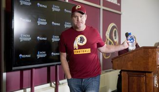 Washington Redskins head coach Jay Gruden leaves a news conference at Redskins Park, Monday, Dec. 31, 2018, in Ashburn, Va. The Washington Redskins ended their season Sunday with a 24-0 loss to the Philadelphia Eagles. (AP Photo/Andrew Harnik)