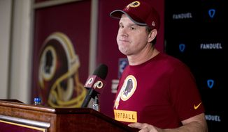 Washington Redskins head coach Jay Gruden listens to a reporter's question during a news conference at Redskins Park, Monday, Dec. 31, 2018, in Ashburn, Va. The Washington Redskins ended their season Sunday with a 24-0 loss to the Philadelphia Eagles. (AP Photo/Andrew Harnik) ** FILE **