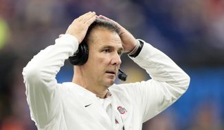 FILE - In this Dec. 1, 2018, file photo, Ohio State head coach Urban Meyer watches from the sidelines during the first half of the Big Ten championship NCAA college football game against Northwestern, in Indianapolis. Meyer had never seen the famous field at the Rose Bowl before this week. The Ohio State coach is wrapping up his career when the Buckeyes face the Washington Huskies in the 105th edition of the Granddaddy of Them All on Tuesday, Jan. 1, 2019.   (AP Photo/AJ Mast, File) **FILE**