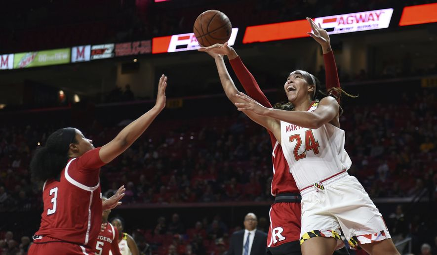 Maryland's Stephanie Jones, right, shoots as Rutgers Charice Wilson, left, defends in the first half of a NCAA college basketball game, Monday, Dec. 31, 2018, in Baltimore. (AP Photo/Gail Burton) **FILE**
