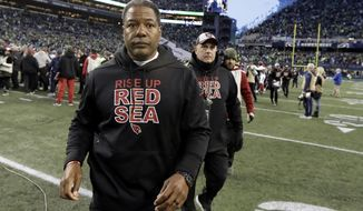 Arizona Cardinals head coach Steve Wilks walks off the field after an NFL football game against the Seattle Seahawks, Sunday, Dec. 30, 2018, in Seattle. The Seahawks won 27-24. (AP Photo/Ted S. Warren)