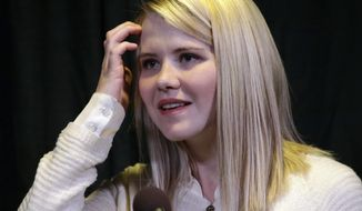 FILE - In this April 24, 2015, file photo, kidnapping survivor Elizabeth Smart looks on during a news conference in Sandy, Utah. Wanda Barzee, a woman who helped kidnap Smart, is living a couple of blocks away from an elementary school in Salt Lake City following her release from prison in September. Utah's online sex-offender registry lists 73-year-old Wanda Barzee as living in a house near a school for kids ages pre-kindergarten through fifth grade. Federal probation officers didn't return a phone message, but Barzee's supervised release guidelines don't seem to prohibit the arrangement. (AP Photo/Rick Bowmer, File)