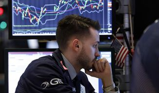 Specialist Matthew Greiner works at his post on the floor of the New York Stock Exchange, Friday, Dec. 28, 2018. U.S. stocks wavered between small gains and losses Friday, struggling to maintain the momentum from a two-day winning streak following a week of volatile trading. (AP Photo/Richard Drew)