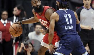 Houston Rockets guard James Harden (13) looks to pass the ball under pressure from Memphis Grizzlies guard Mike Conley (11) during the first half of an NBA basketball game Monday, Dec. 31, 2018, in Houston. (AP Photo/Michael Wyke)