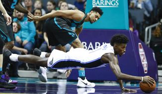 Orlando Magic forward Jonathan Isaac, right, dives for the ball while being covered by Charlotte Hornets guard Jeremy Lamb in the first half of an NBA basketball game Monday, Dec. 31, 2018, in Charlotte, N.C. (AP Photo/Jason E. Miczek)