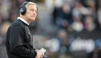 FILE - In this Nov. 3, 2018 file photo, Iowa head coach Kirk Ferentz looks at the scoreboard while playing Purdue in the second half of an NCAA college football game in West Lafayette, Ind. The Hawkeyes make their sixth Outback Bowl appearance Tuesday, Jan. 1, 2019, when they face No. 18 Mississippi State. (AP Photo/AJ Mast, File)