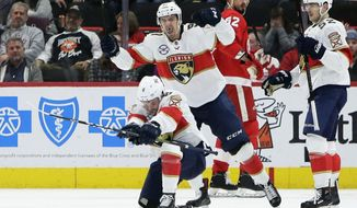 Florida Panthers center Jayce Hawryluk (8) celebrates with right wing Juho Lammikko (91), of Finland, after scoring against the Detroit Red Wings during the second period of an NHL hockey game Monday, Dec. 31, 2018, in Detroit. (AP Photo/Duane Burleson)