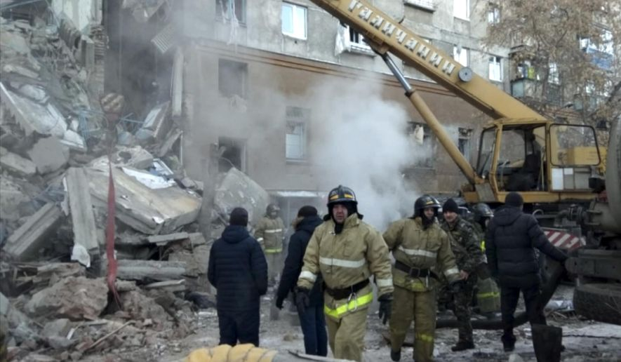 This photo provided by the Russian Emergency Situations Ministry taken from tv footage shows Emergency Situations employees working at the scene of a collapsed section of an apartment building, in Magnitigorsk, Russia, Monday, Dec. 31, 2018. Dozens of people are believed to be under the rubble after a gas explosion in a house in Russia's Urals city of Magnitogorsk, Governor of the Chelyabinsk Region said on Monday.(Russian Ministry for Emergency Situations photo via AP)