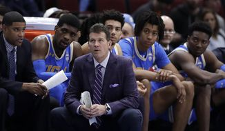 File-This Dec. 22, 2018, file photo shows UCLA head coach Steve Alford and his players watching during the second half of an NCAA college basketball game against Ohio State, in the fifth annual CBS Sports Classic, in Chicago.  Alford has been fired as UCLA basketball coach after six seasons, with the Bruins mired in a four-game skid that included losses at home to Belmont and Liberty. Athletic director Dan Guerrero said Monday, Dec. 31, 2018, that assistant Murry Bartow will serve as interim coach through the end of the season. (AP Photo/Nam Y. Huh, File) **FILE**