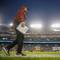 Washington Redskins head coach Jay Gruden stands on the sideline in the first half of an NFL football game against the Philadelphia Eagles, Sunday, Dec. 30, 2018, in Landover, Md. The Eagles defeated the Redskins 24-0. (AP Photo/Andrew Harnik)