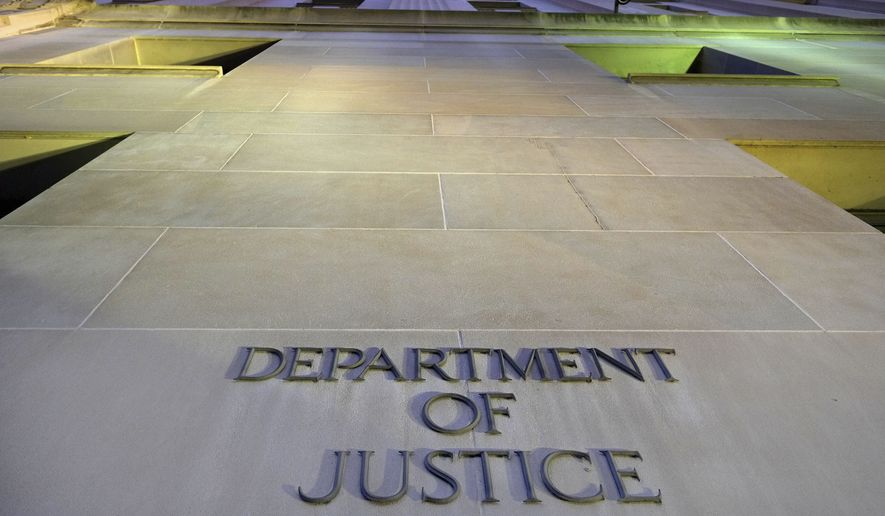In this May 14, 2013, file photo, the Department of Justice headquarters building in Washington is photographed early in the morning. (Associated Press)