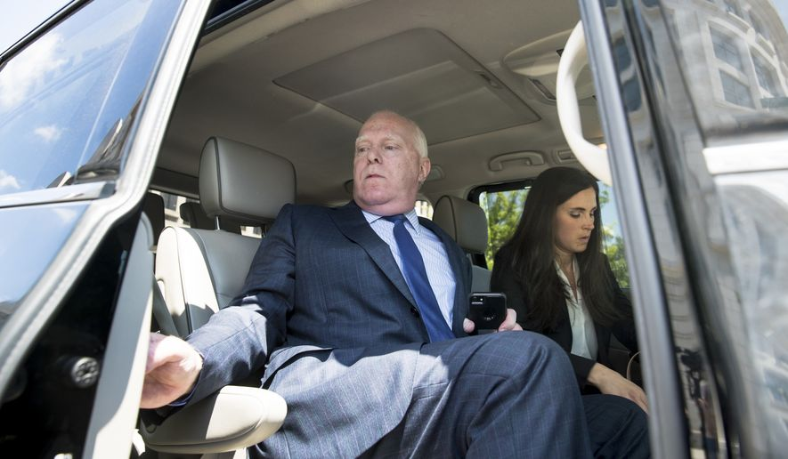 Attorneys Eric Dubelier, left, and Katherine Seikaly, right, representing Concord Management and Consulting LLC, leave federal court in Washington, Wednesday, May 9, 2018, after pleading not guilty on behalf of the company, which has been charged as part of a conspiracy to meddle in the 2016 US presidential election. (AP Photo/Andrew Harnik)