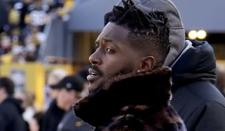 Pittsburgh Steelers wide receiver Antonio Brown, left, stands with former Steelers quarterback Charlie Batch on the sideline before an NFL football game against the Cincinnati Bengals, Sunday, Dec. 30, 2018, in Pittsburgh. (AP Photo/Gene J. Puskar) ** FILE **