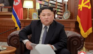 """In this photo released on Tuesday, Jan. 1, 2019, North Korean leader Kim Jong-un delivers a New Year's speech in North Korea. Kim says he hopes to extend his high-stakes nuclear summitry with President Donald Trump into 2019, but also warns Washington not to test North Koreans' patience with sanctions and pressure. The content of this image is as provided and cannot be independently verified. Korean language watermark on the image as provided by the source reads: """"KCNA"""" which is the abbreviation for Korean Central News Agency. (Korean Central News Agency/Korea News Service via AP)"""