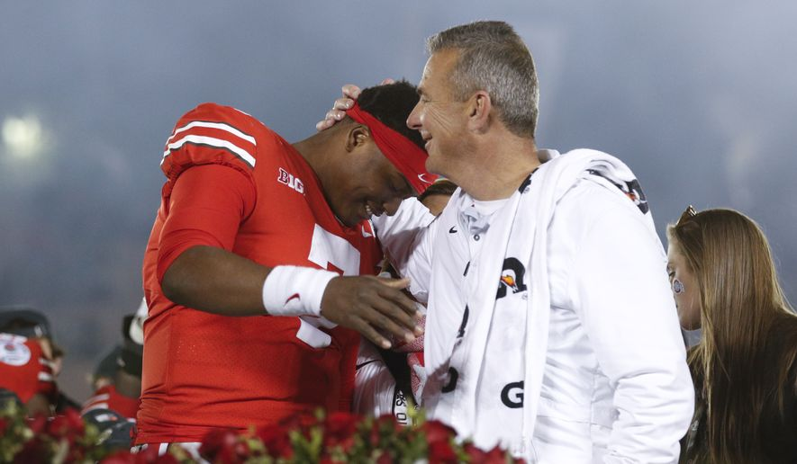 Ohio State coach Urban Meyer, right, celebrates with quarterback Dwayne Haskins after Ohio State's 28-23 win over Washington in the Rose Bowl NCAA college football game Tuesday, Jan. 1, 2019, in Pasadena, Calif. (AP Photo/Jae C. Hong)