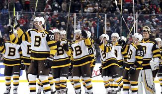 Boston Bruins players celebrate after they defeated the Chicago Blackhawks 4-2 in the NHL Winter Classic hockey game at Notre Dame Stadium, Tuesday, Jan. 1, 2019, in South Bend, Ind. (AP Photo/Nam Y. Huh)
