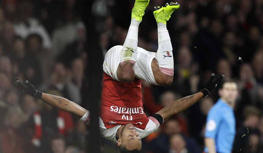 Arsenal's Pierre-Emerick Aubameyang celebrates after scoring his side's fourth goal during the English Premier League soccer match between Arsenal and Fulham at Emirates stadium in London, Tuesday, Jan. 1, 2019. (AP Photo/Kirsty Wigglesworth)
