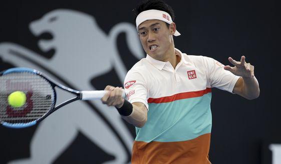 Kei Nishikori of Japan plays a shot during his match against Denis Kudla of the United States at the Brisbane International tennis tournament in Brisbane, Australia, Wednesday, Jan. 2, 2019. (AP Photo/Tertius Pickard)