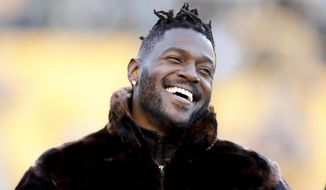 Pittsburgh Steelers wide receiver Antonio Brown stands along the sideline in street clothes before an NFL football game against the Cincinnati Bengals, Sunday, Dec. 30, 2018, in Pittsburgh. (AP Photo/Don Wright) **FILE**