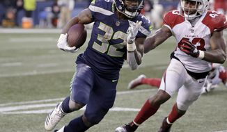 Seattle Seahawks' Chris Carson carries as Arizona Cardinals' Haason Reddick (43) pursues during the second half of an NFL football game, Sunday, Dec. 30, 2018, in Seattle. (AP Photo/Ted S. Warren)